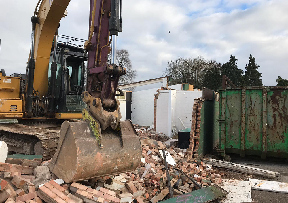 Site clearance using digger and excavator